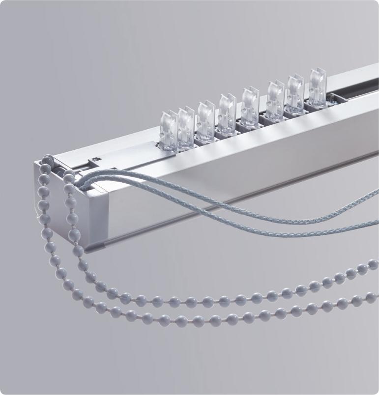 Subtilní ovládací systém vertikální žaluzie